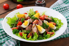 Warm salad with chicken liver, green beans, eggs, tomatoes Stock Image