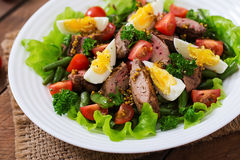 Warm salad with chicken liver, green beans, eggs, tomatoes Royalty Free Stock Image