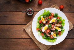 Warm salad with chicken liver, green beans, eggs, tomatoes Stock Images