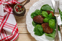 Warm salad of chicken liver with spinach and Basil Stock Image