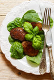Warm salad of chicken liver with spinach and Basil Stock Photos