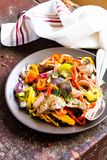 Warm salad with chicken liver and sweet pepper. Selective focus Stock Images