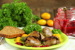 Warm salad with chicken liver, sweet peppers, cherry tomatoes and salad mix Stock Photo