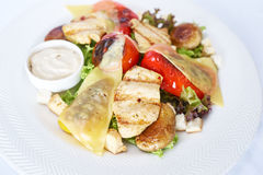 Warm salad with chicken Stock Photo