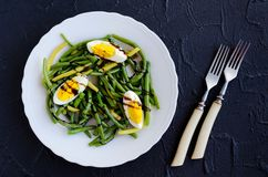 Warm salad with cooked green beans and boiled eggs Royalty Free Stock Photography