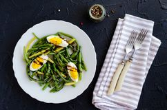 Warm salad with cooked green beans and boiled eggs Stock Photography