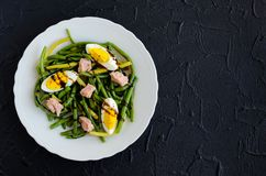 Warm salad with cooked green beans, tuna and boiled eggs Stock Photos
