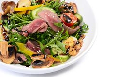 Warm salad with a cutting of a lamb Stock Images