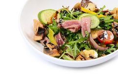 Warm salad with a cutting of a lamb Royalty Free Stock Images