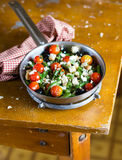 Warm salad with french beans, cherry tomatoes, black olives, feta cheese and wheat croutons Royalty Free Stock Image