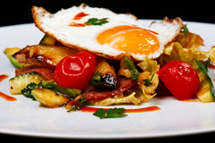 Warm Salad with Fried Egg Royalty Free Stock Image