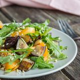 Warm salad with fried eggplant, arugula, cherry tomatoes, royalty free stock images