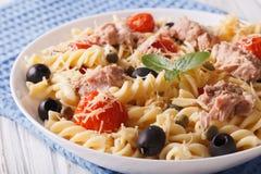 Warm salad fusilli pasta, tuna and tomatoes close up. horizontal Royalty Free Stock Photography