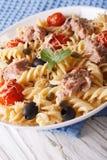 Warm salad fusilli pasta, tuna and tomatoes close up. Vertical Royalty Free Stock Photo