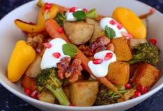 Warm salad with greek yogurt Royalty Free Stock Images