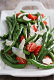 Warm salad with green beans and parmesan cheese Stock Image