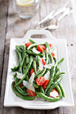Warm salad with green beans and parmesan cheese Royalty Free Stock Image