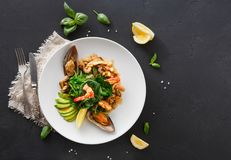 Warm salad with grilled seafood flat lay Stock Image