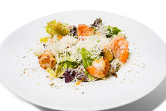 Warm salad with grilled shrimps. Stock Photos