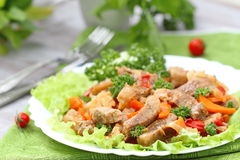 Warm salad with meat and vegetables Stock Photo