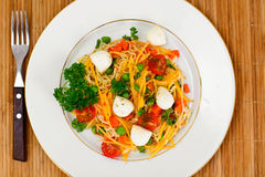 Warm Salad of Noodles, Pumpkin, Carrots, Peas with Cherry Tomato Stock Photos