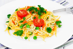 Warm Salad of Pasta with Pumpkin, Carrots, Peas and Cherry Tomat Stock Photo