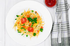 Warm Salad of Pasta with Pumpkin, Carrots, Peas and Cherry Tomat Stock Photography
