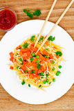Warm Salad of Pasta with Pumpkin, Carrots, Peas and Cherry Tomat Royalty Free Stock Image