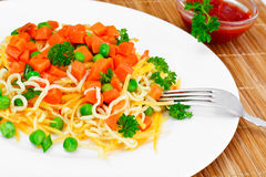 Warm Salad of Pasta with Pumpkin, Carrots, Peas and Cherry Tomat Stock Image