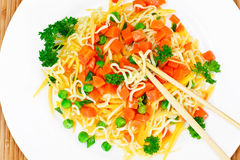 Warm Salad of Pasta with Pumpkin, Carrots, Peas and Cherry Tomat Royalty Free Stock Images