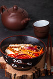 Warm salad of rice noodles with fresh vegetables and fried chicken Stock Photo
