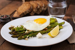 Warm salad of roasted asparagus, feta cheese. Stock Image