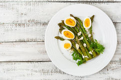 Warm salad of roasted asparagus, feta cheese and eggs. Royalty Free Stock Images