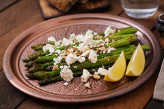 Warm salad of roasted asparagus, feta cheese. Royalty Free Stock Photo