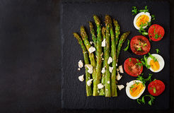 Warm salad of roasted asparagus, feta cheese, tomatoes and eggs. Stock Images