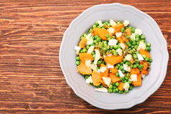 Warm salad with roasted pumpkin, peas and cheese brie Stock Photo