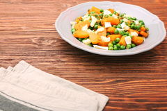 Warm salad with roasted pumpkin, peas and cheese brie Stock Image