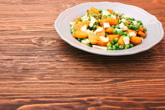 Warm salad with roasted pumpkin, peas and cheese brie Royalty Free Stock Photography