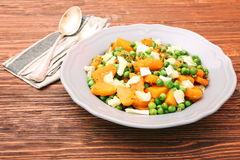 Warm salad with roasted pumpkin, peas and cheese brie Royalty Free Stock Photo
