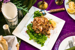 Warm salad with seafood and herbs stock images