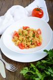 Warm salad with seafood in a white bowl on a wooden background Royalty Free Stock Photo