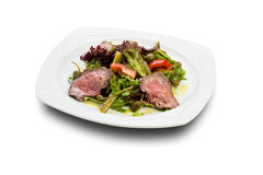 Warm salad with sliced roast beef Stock Photo