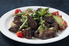 Warm salad from turkey liver Stock Image