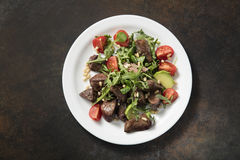 Warm salad from turkey liver Royalty Free Stock Image