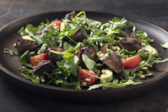 Warm salad from turkey liver Stock Images