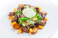 Warm salad with turkey liver and poached egg.  stock image