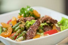 Warm salad with veal Stock Images