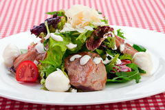Warm salad with veal meat Stock Images