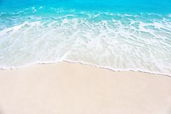 Warm sand and sea waves on beach stock photo