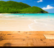 Warm sandy beach in caribbean by wooden decking Royalty Free Stock Photography